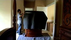 Moving Tips- D.C movers wrap a dresser