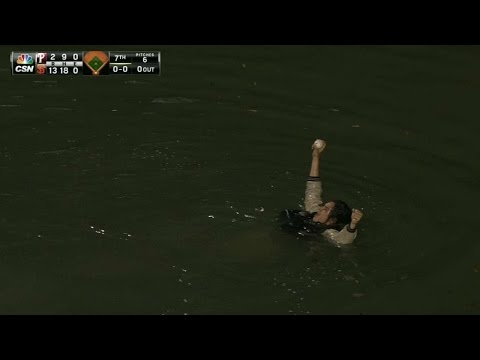 Fan jumps in McCovey Cove for Panik's homer
