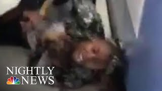 NYPD Reviewing Video Of Officers Prying Baby From Mom's Arms | NBC Nightly News
