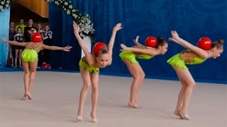 group exercises with ball girl on rhythmic gymnastics competitions