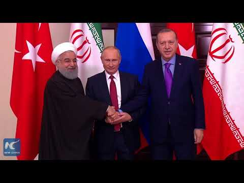 Russia, Turkey, Iran push for political settlement for Syria