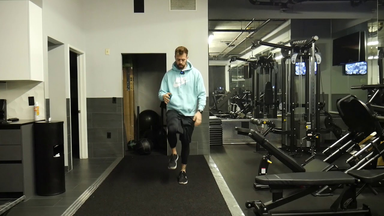 How to perform: Knee grab to reverse lunge