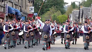 2019 Street Parade of 11 Pipe Bands marching through Pitlochry town centre in Perthshire, Scotland