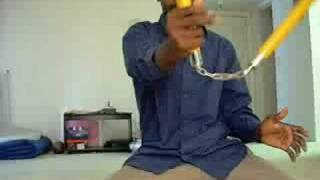 Nunchaku trick wrist roll