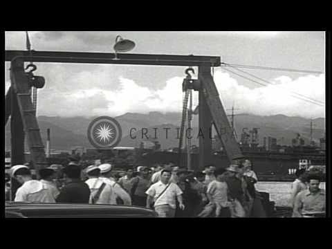 Civilian workers disembark from the ferries from Ford Island which land at Pearl ...HD Stock Footage