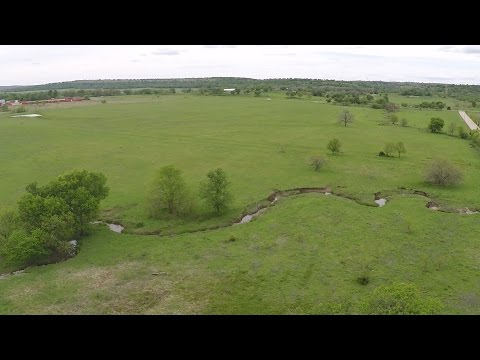 Farmhouse with 57+ Acres, wet weather creek and ponds