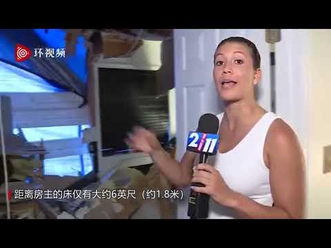 惊险视频:汽车直插民宅屋顶 离熟睡夫妇仅1.8米(图/视频)