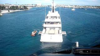 Helicopter landing on a superyacht in the Bahamas