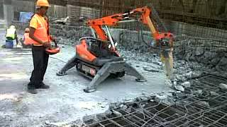 Robotic Demolition Machine Demolishing Concrete Slab - Dishmaan.com