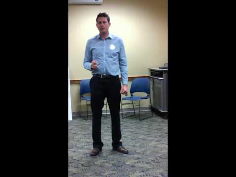Joey McKennon speaking at District #14