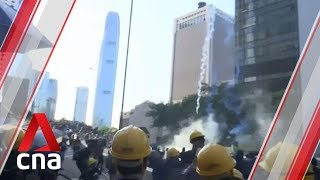 Hong Kong police drop tear gas onto protesters from atop buildings