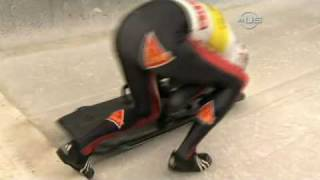 Skeleton sled flips over, but saved - from Universal Sports
