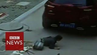 Chinese boy unhurt after car runs over him - BBC News
