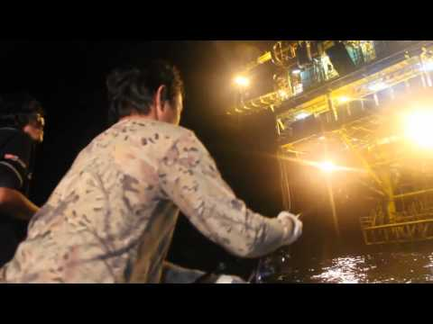 Offshore fishing at Natural gas drilling rig. fishingEZ