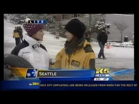 2012 Seattle Snow - KING 5 reporter accosted by an angry snow tuber!