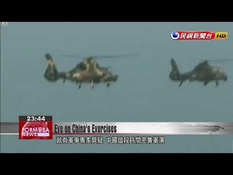 Taiwan watches cautiously as China talks up military drills in Fujian