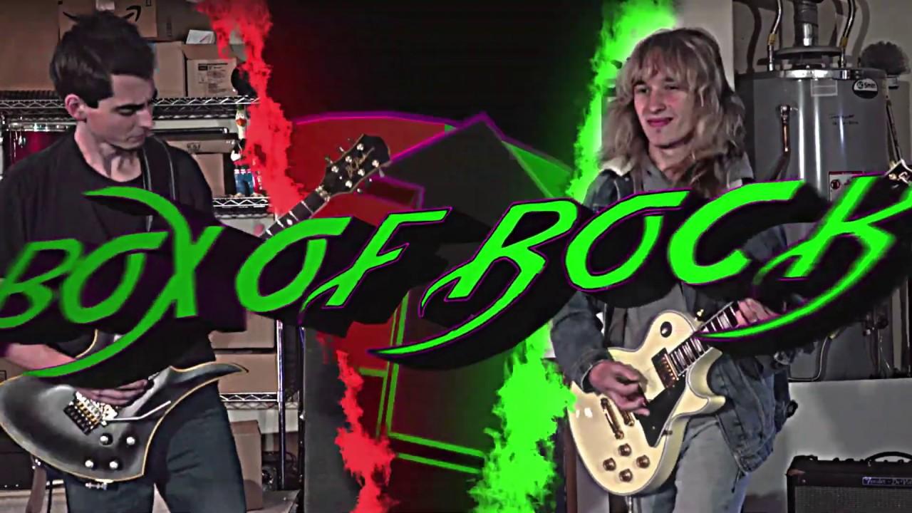 'Box of Rock' - Guitar Battle!  |Official Music Video|