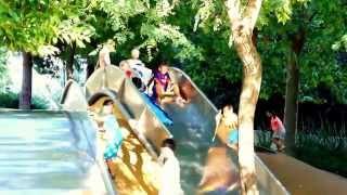 Sunny Toboggan Playground Slides In Barcelona