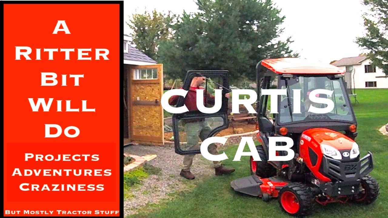 KUBOTA TRACTOR BX23S CURTIS CAB MOWING AND STAYING WARM!