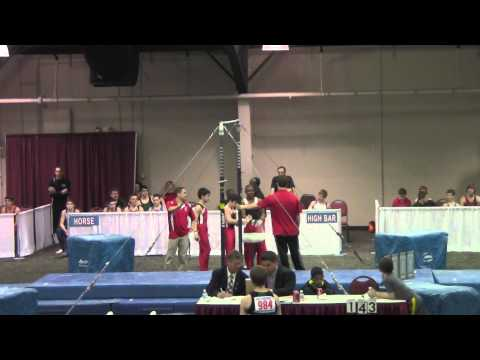 Amazing catch! Coach catches gymnast while falling off the bar!