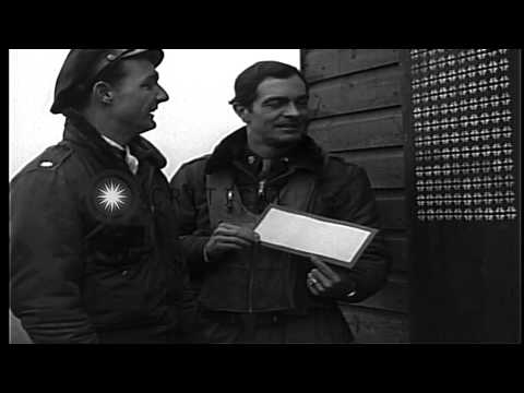 Pilots of the USAAF 334th Fighter Squadron on the ground at Debden Airfield in En...HD Stock Footage