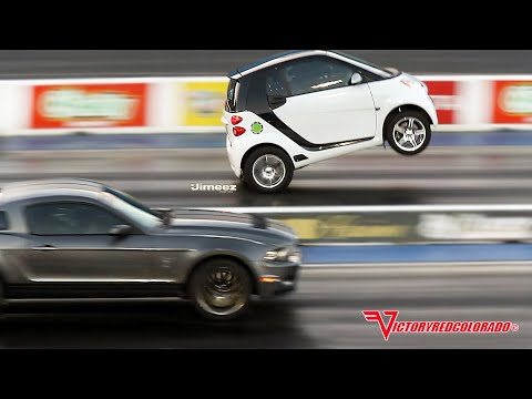 Wheelstanding N Smart Car Outruns Mustangs