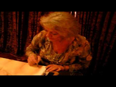 Margaret Nolan signing my painting of her
