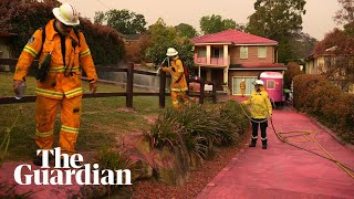 NSW fires: homes in Sydney's South Turramurra covered in pink fire retardant