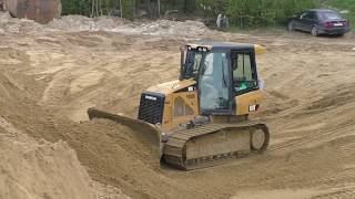 Cat D5K XL pushing sand