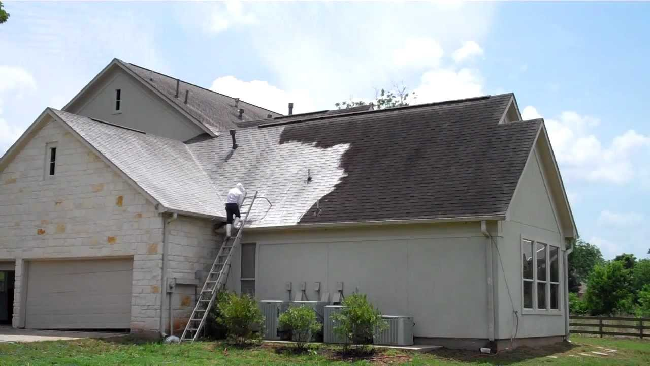 Roof Cleaning And Power Washing Of A House And Tall Steep