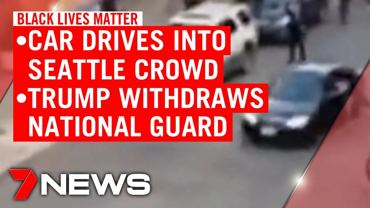 An armed Black Lives Matter protester confronted a car that drove ...