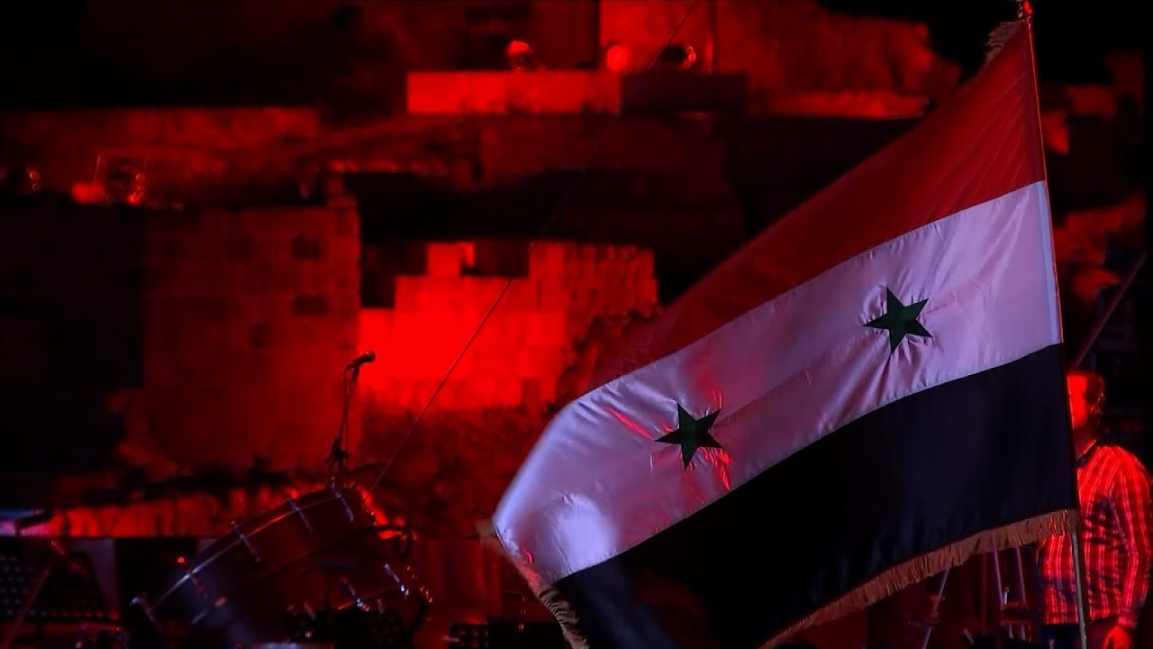 pro-assad-syrians-celebrate-independence-day-itv-news