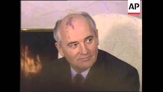 President Ronald Reagan and Soviet Leader Mikhail Gorbachev answer Questions from reporters