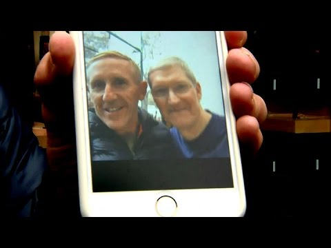CEO Tim Cook takes selfies with Apple iPhone 7 customers in Palo Alto