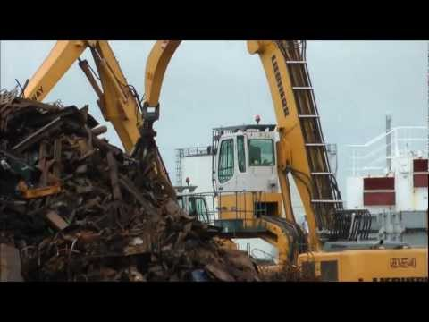 Liebherr 954 excavator loading ship with scrap metal