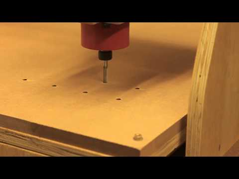 My DIY CNC. Making clap-down holes on working table