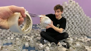 I MADE A BALL out of a 1000 DUCT TAPE ROLLS !