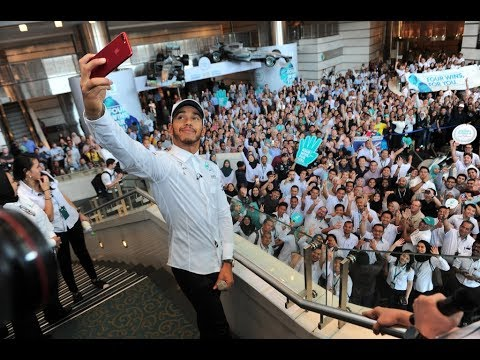 Lewis Hamilton celebrates the championships with his colleagues at Petronas