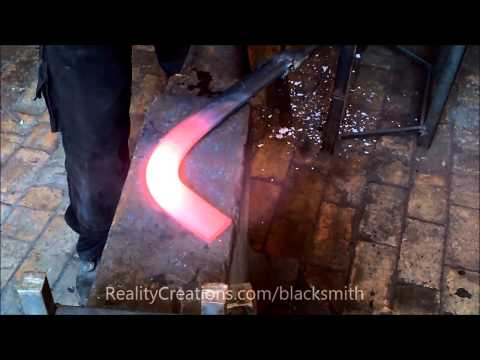 Making a right angle bend in hot iron convex bar from forge
