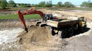 Excavator at work-loading Dump trucks