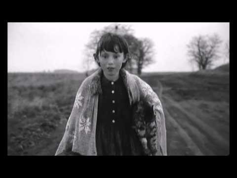 Girl walking with her dead cat  Sátántangó  Bela Tarr  1994