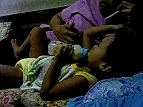 Alvin Jay Lariosa While Drinking His Milk