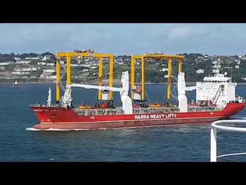 Heavy Lift Vessel carrying cranes passing Crude Oil Tanker