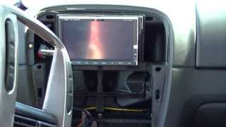 How to hook up an amp in a 2010 camaro with out replacing the factory radio.