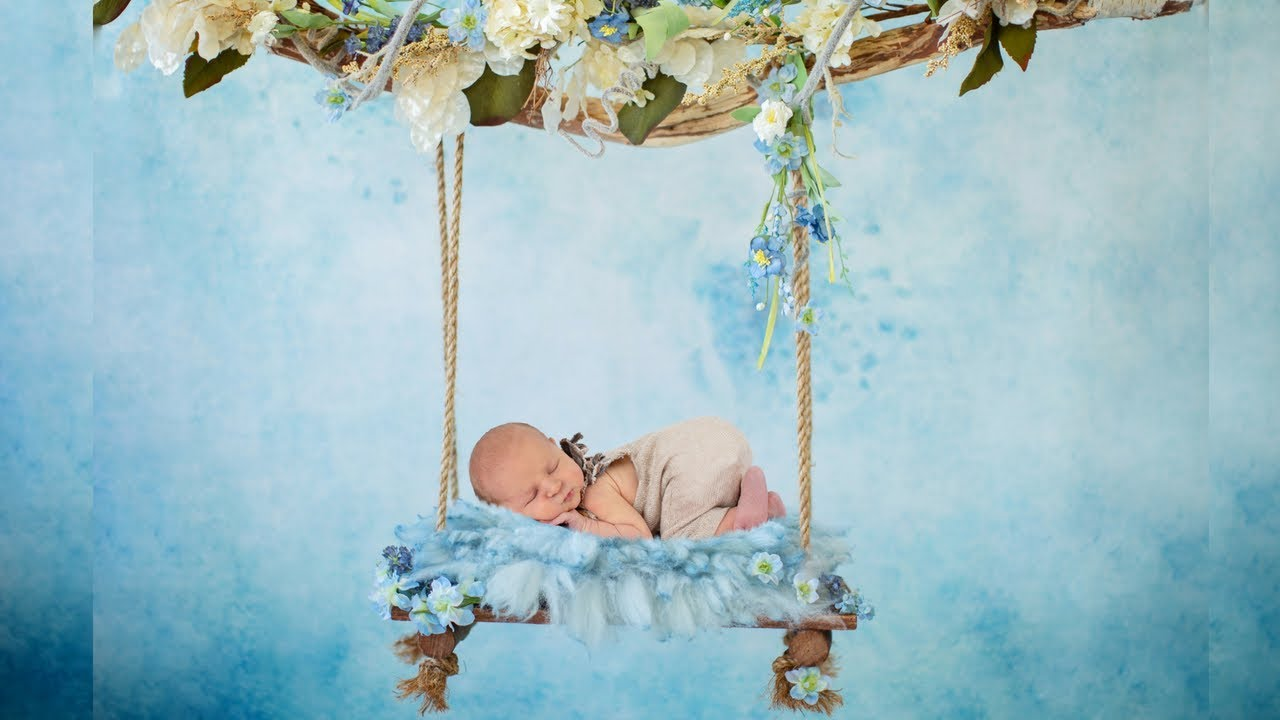 Newborn photo session for a baby boy enhancing newborn photography with digital backgrounds