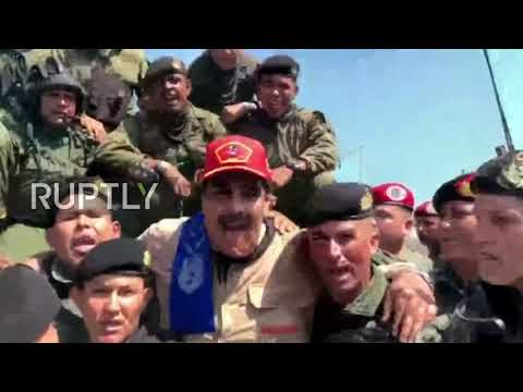 Venezuela: Maduro jogs alongside soldiers, rides tank in military exercise