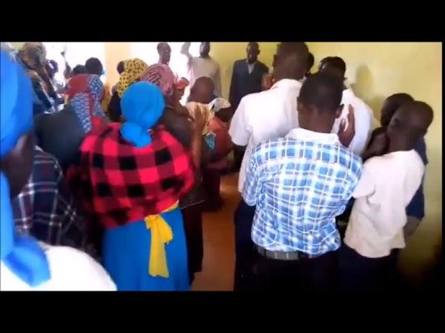 Praying for Woman Seeking Jesus in Mois Bridge Kenya