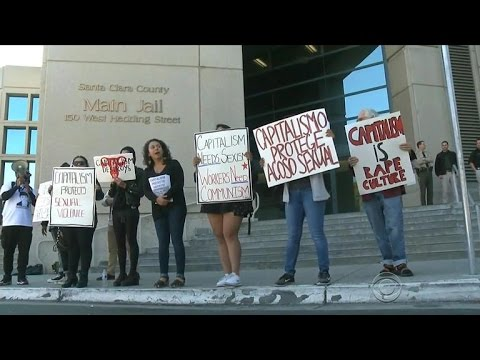 Protesters gather outside the home of Brock Turner