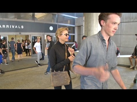Annette Bening Hides Behind Son Benjamin Beatty At LAX
