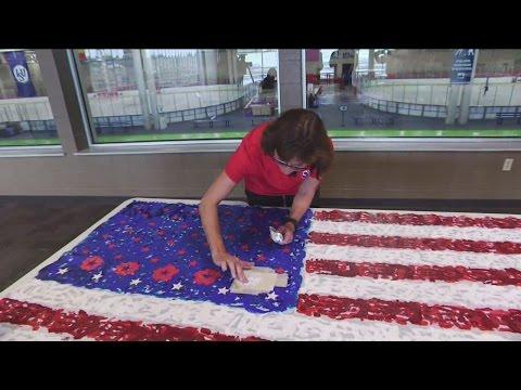 Bonnie Blair Cruikshank paints star on Flag of Hope